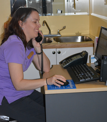 A team member on the phone with a client